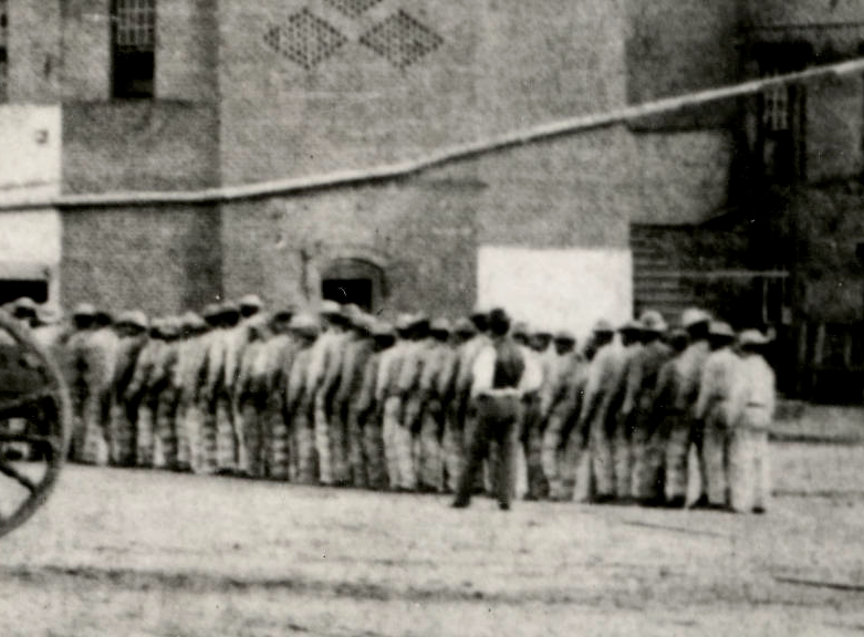 Close-up of Prison yard in Huntsville, circa 1873-1875, showing prisoners of color.